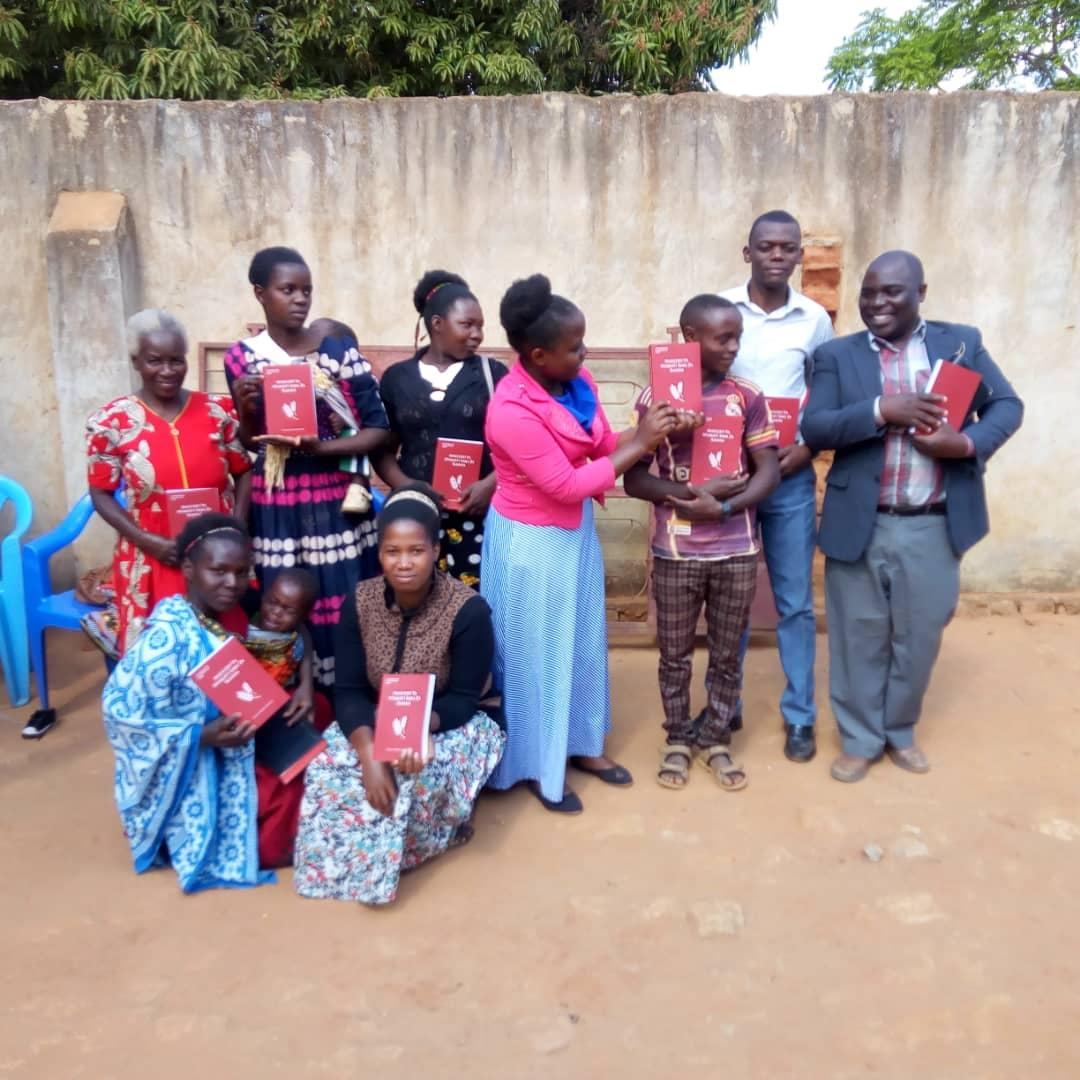 Believers in Africa receiving Swahili Church age Books printed through Vision Books.